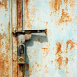 Padlock to lock door iron rusting — Stock Photo #11475532