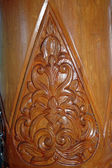 Brown wood carvings on the pole — Stock Photo