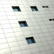 Square pattern on the building with some windows — Stock Photo