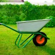 Stock Photo: Gardener Green Wheel Barrow