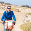 Woman having a excursion on bike — Stock Photo