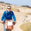 Womhaving excursion on bike — Stock Photo #10811011
