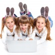 Three attractive girl using a laptop — Stock Photo