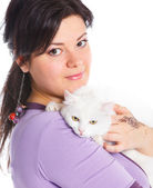 Young woman hold white cat. — Stockfoto