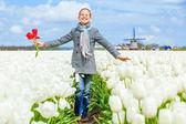 Girl in the purple tulips field — Stock Photo