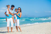 Family having fun on tropical beach — Stock Photo
