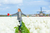 Girl in the purple tulips field — Stock Photo