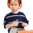Stock Photo: Boy in hard hat with brick