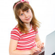 Young girl using notebook computer — Stock Photo