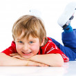 Cute boy lying on floor — Stock Photo #11053864