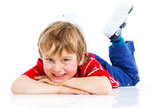 Cute boy lying on floor — Stock Photo