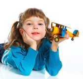 Cute little girl playing with a toy airplane — Stock Photo