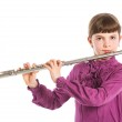 Girl playing transverse flute — Stock Photo #11095601