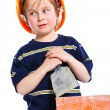 Boy in hard hat with brick — Stock Photo