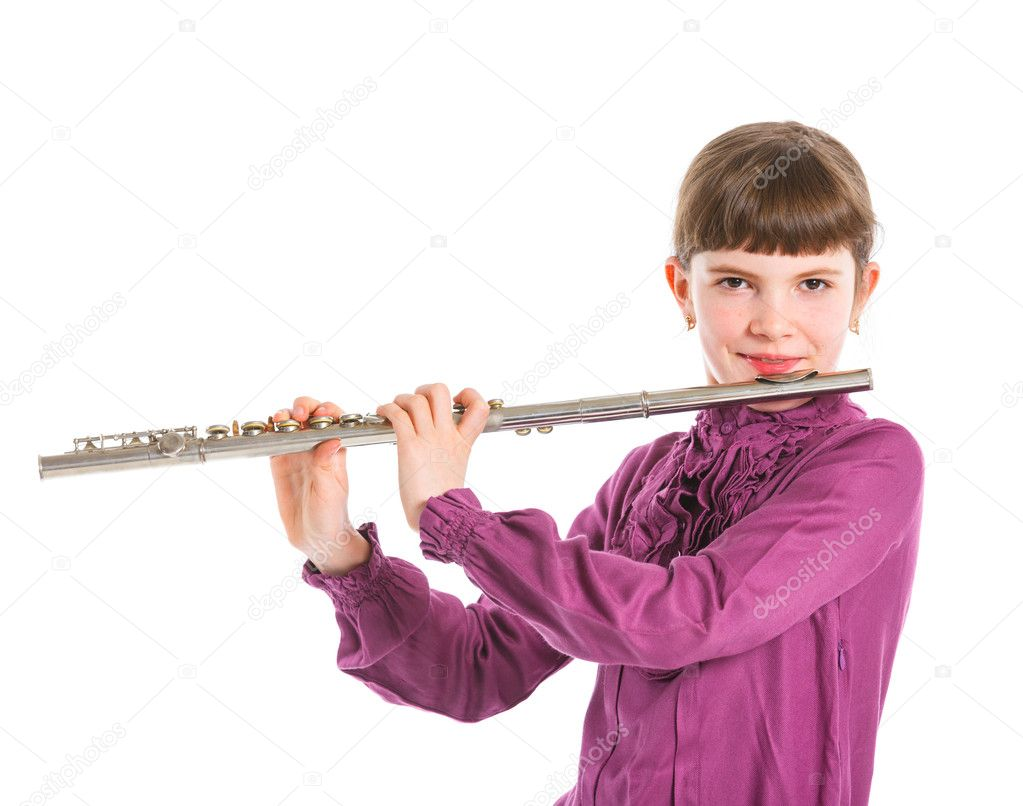 Portrait of a cute girl playing transverse flute. Isolated on a white background  Stock Photo #11134953