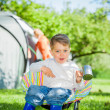 Boy in the camping great outdoors — Stock Photo