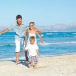 Happy family on tropical beach — Stock Photo #11225439