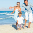 Happy family on tropical beach — Stock Photo #11225537