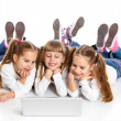 Three attractive girl using a laptop — Stock Photo #11359679