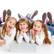 Stock Photo: Three attractive girl using laptop