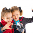 Two young girls with a camera — Stock Photo