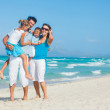 Family having fun on tropical beach — Stock Photo #11359910