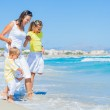 Happy family on tropical beach — Stock Photo #11399756