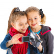 Two young girls with a camera — Stock Photo #11477638