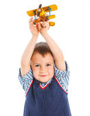 Cute little boy playing with a toy airplane — Stock Photo