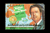 Moammar Gadhafi and postmark — Stock Photo
