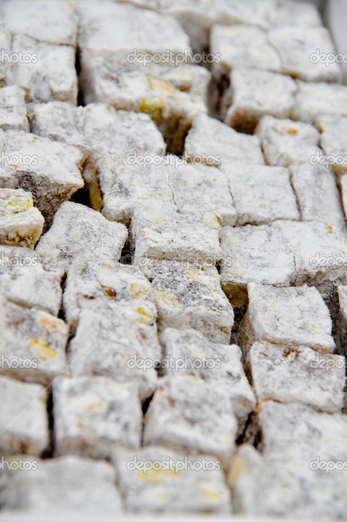 Turkish delight with nuts sprinkled with powdered sugar and coconut — Stock Photo #11173084