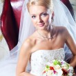 Stock Photo: Beautiful bride sitting in red armchair