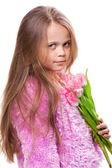Beautiful little girl with bouquet of pink tulips isolated on white — Stock Photo
