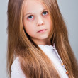 Beautiful little girl with long blonde hair — Stock Photo #11057812