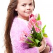 Stock Photo: Beautiful little girl with bouquet of pink tulips isolated on white