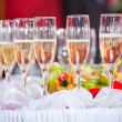 Glasses of champagne on festive table — Stok fotoğraf