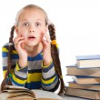 Surprised girl  reading books on isolated white - Stock Photo