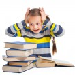 Schoolgirl with horror looking at pile of books on isolated white — Stock Photo