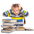 Schoolgirl with horror looking at pile of books on isolated white - Stock Photo