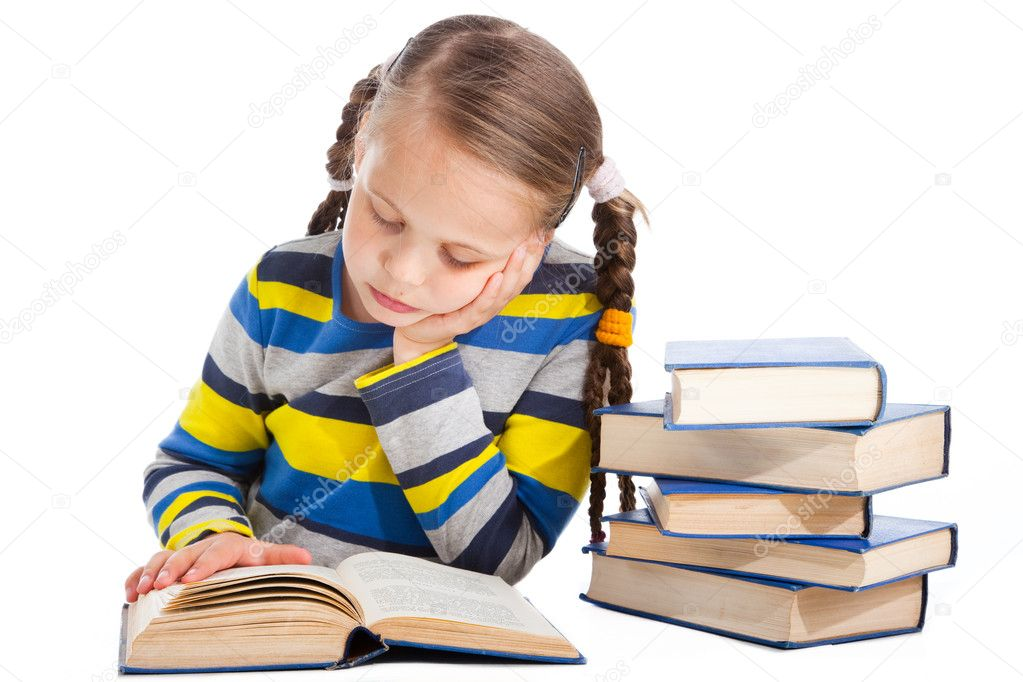 Portrait of cute schoolgirl  attentively reading the book on isolated white background — Stock Photo #11443752