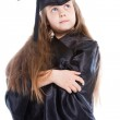 Cute girl in black academic cap and gown — Stock Photo