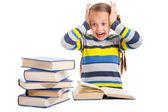 Schoolmeisje met horror kijken naar stapel boeken op geïsoleerde wit — Stockfoto