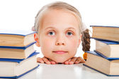 Girl between the books on isolated white — Stock Photo