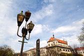 Old lantern in city over sky — Stock Photo