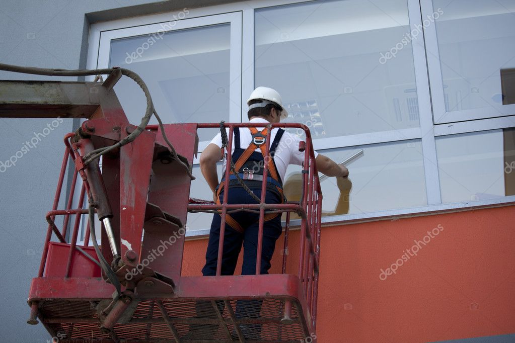 Cleaning windows from outside — Stock Photo #10816568