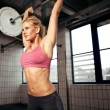 Foto Stock: Woman Lifting Weight