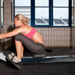 Woman On Indoor Rowing Machine — Stockfoto