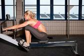 Woman On Indoor Rowing Machine — Stock Photo