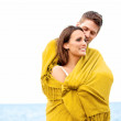 Stock Photo: Couple Wrapped with Blanket Embracing
