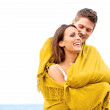 Couple Wrapped in Blanket Looking Happy — Stock Photo